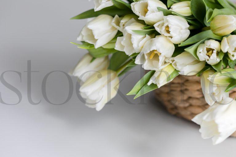 Horizontal stock photo of flowers in basket