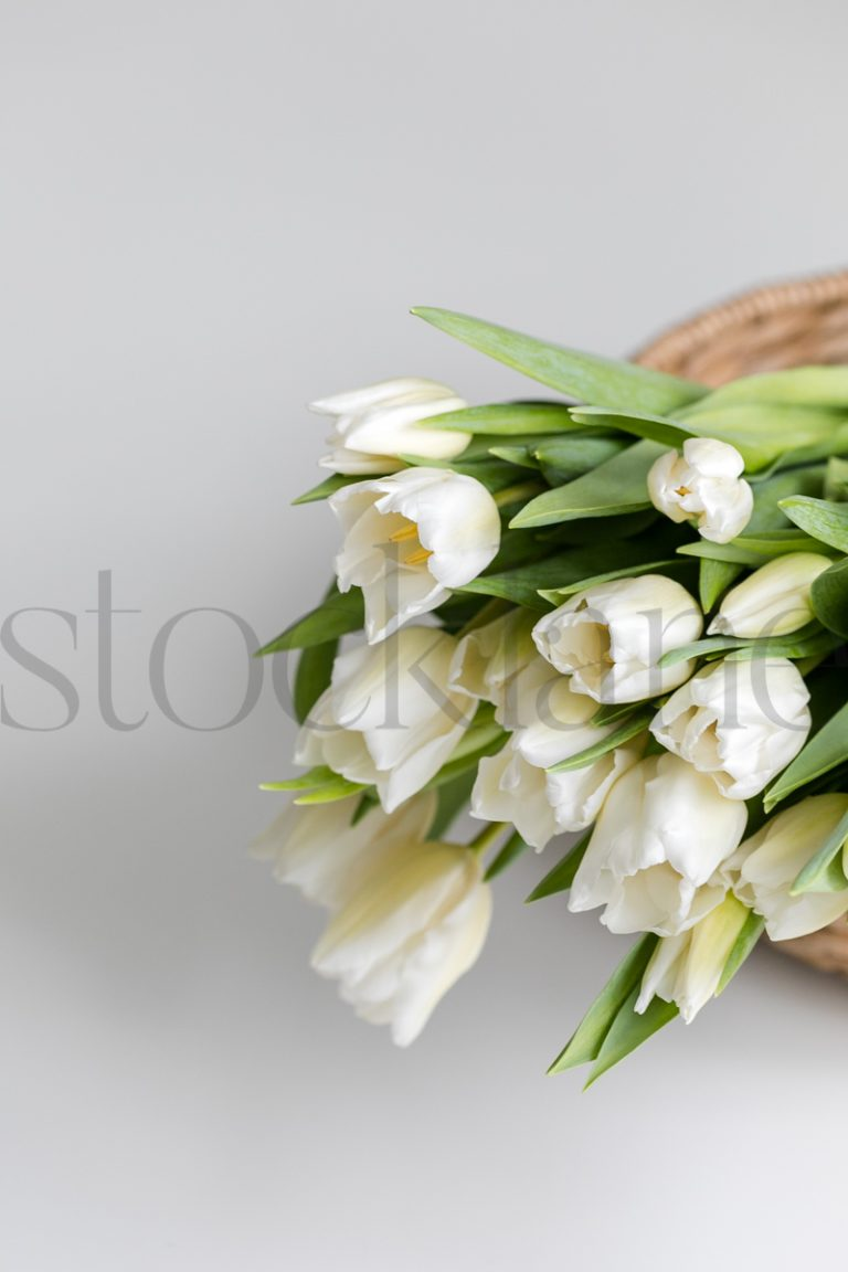 Vertical stock photo of flowers in basket