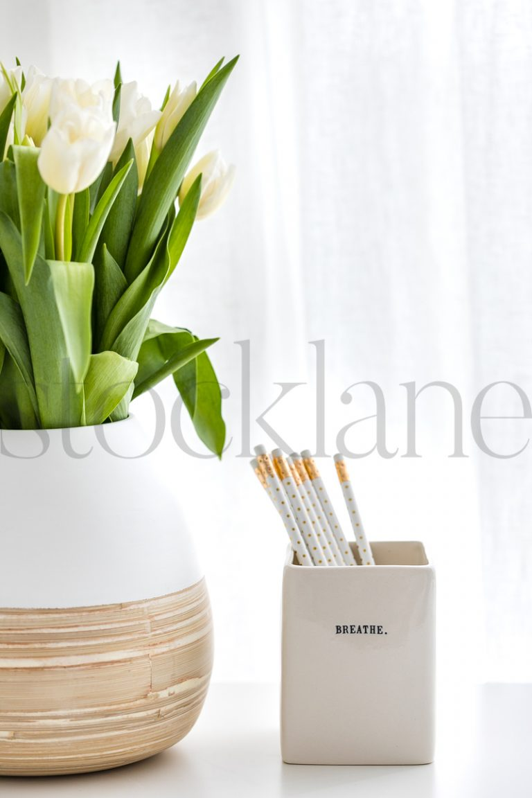 Vertical stock photo of pencils and flowers