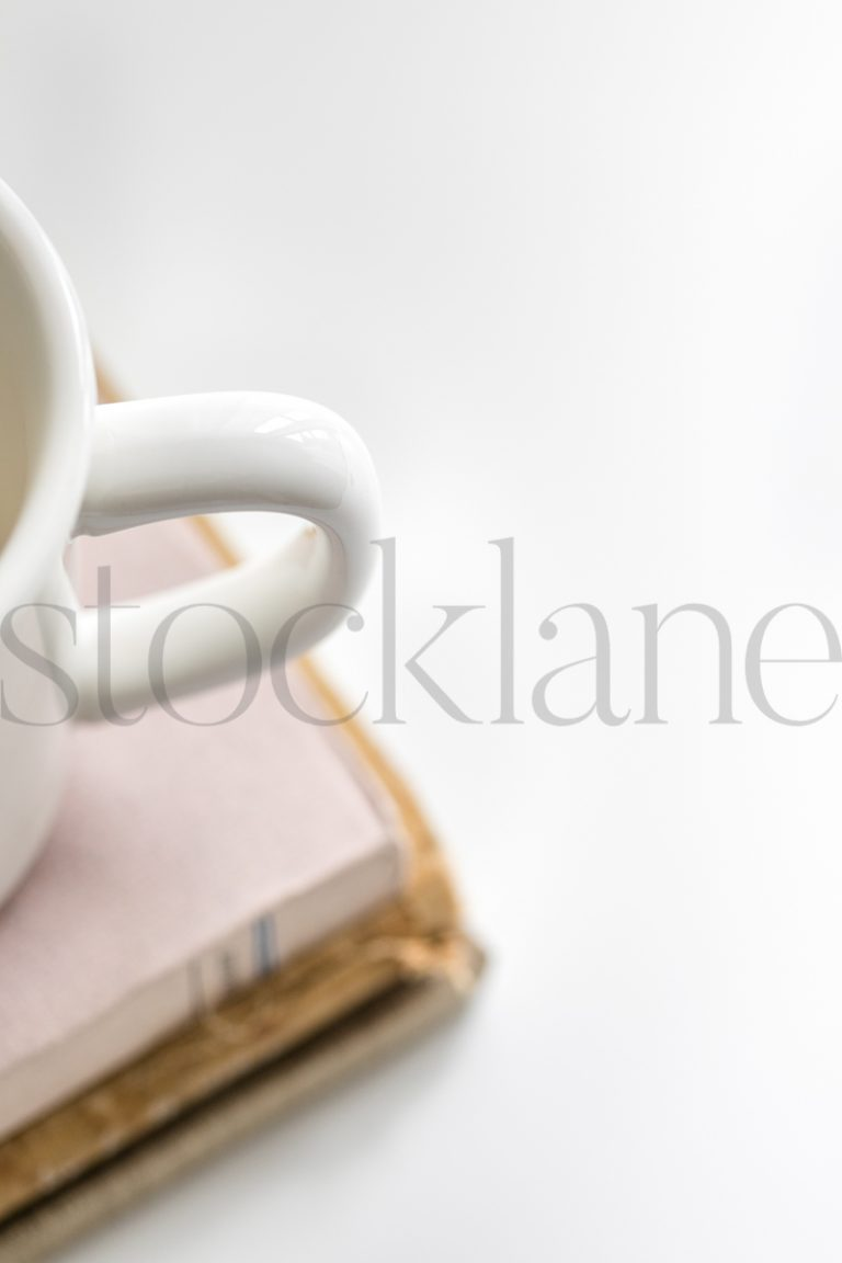 Vertical stock photo of coffee cup and books