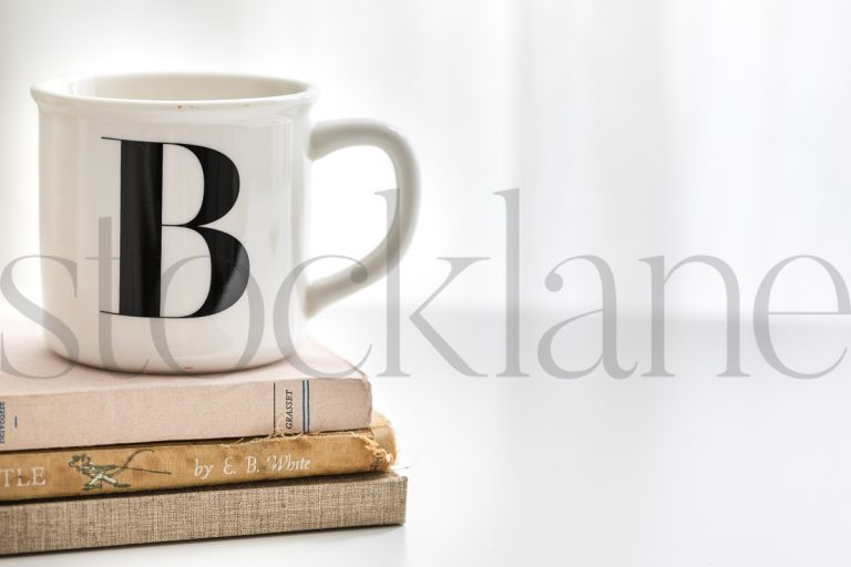 Horizontal stock photo of coffee cup and books