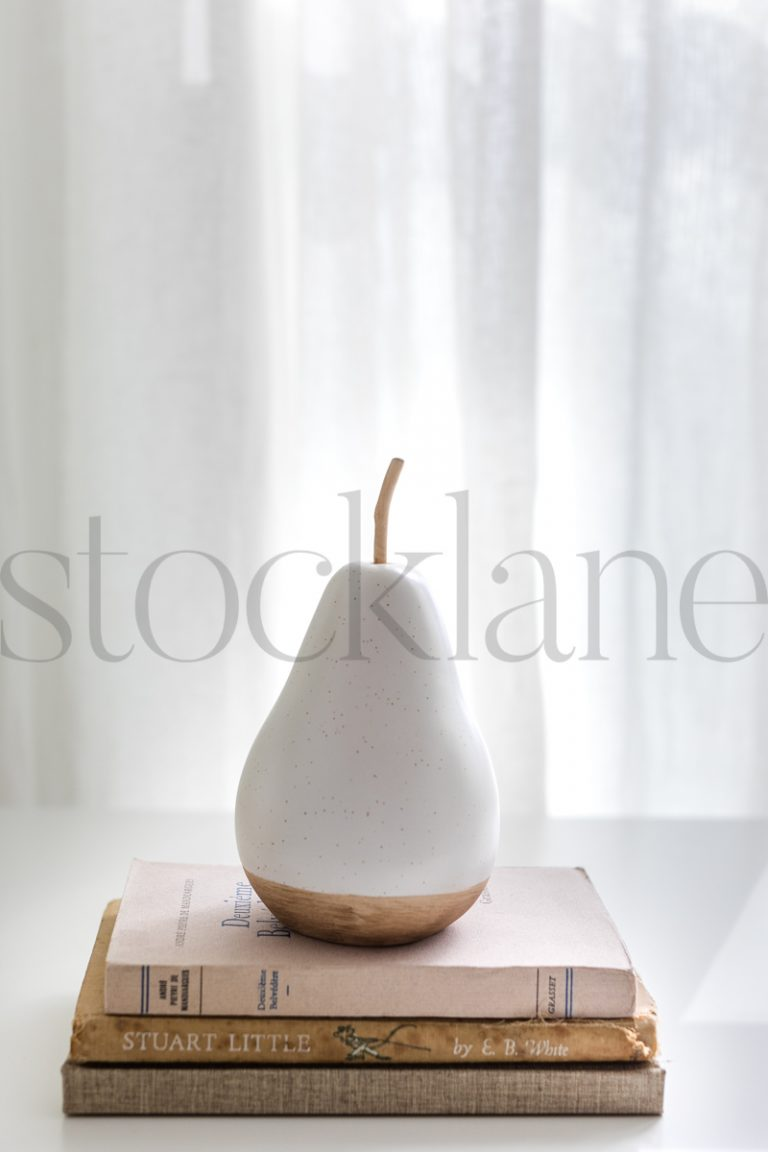 Vertical stock photo of book and pear