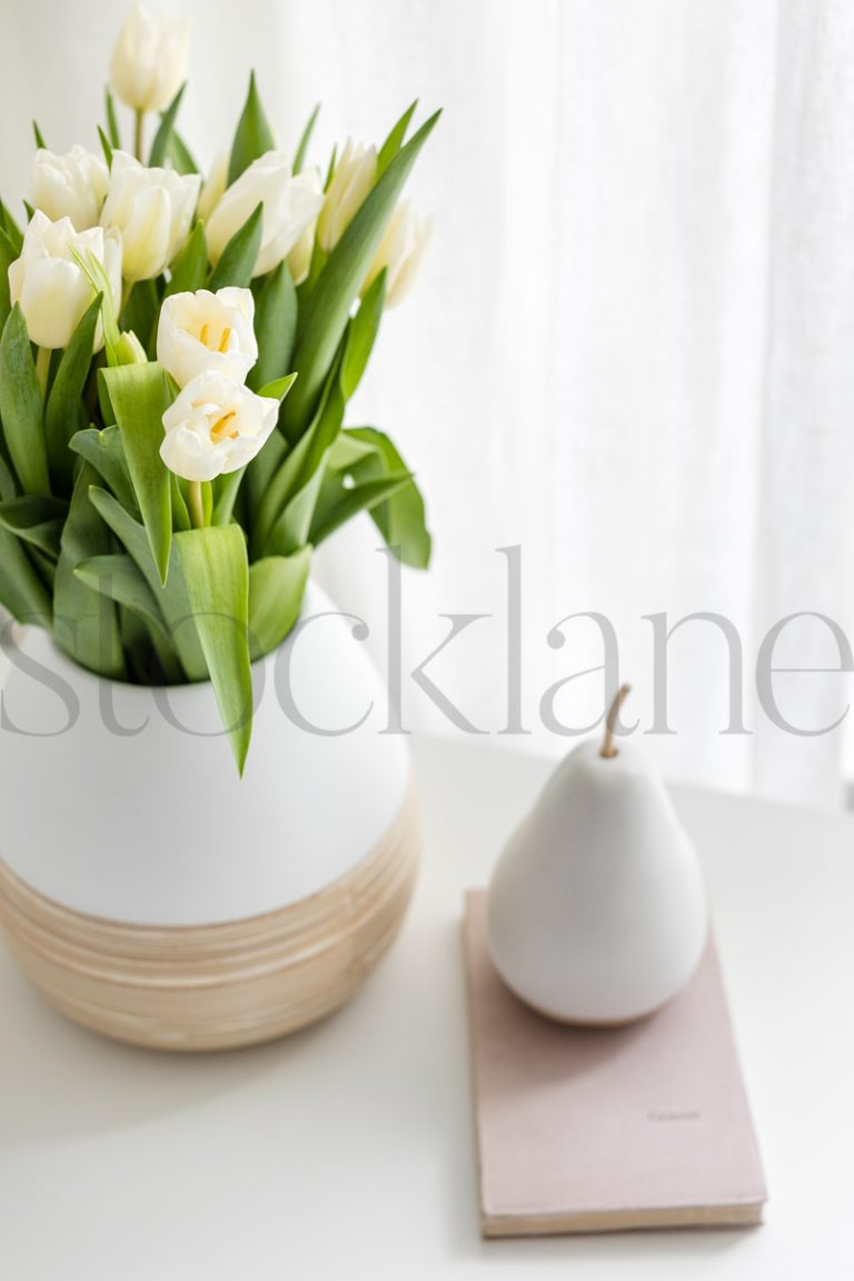 Vertical stock photo of pear and flowers