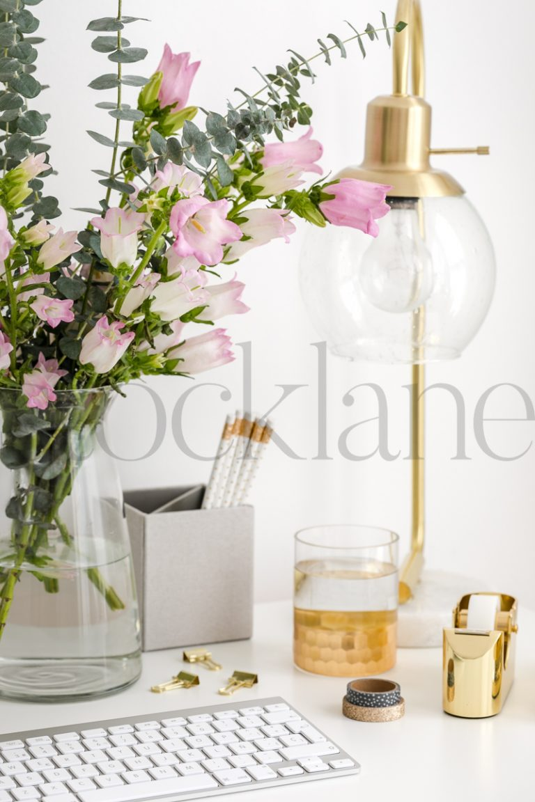 Vertical stock photo of feminine desktop