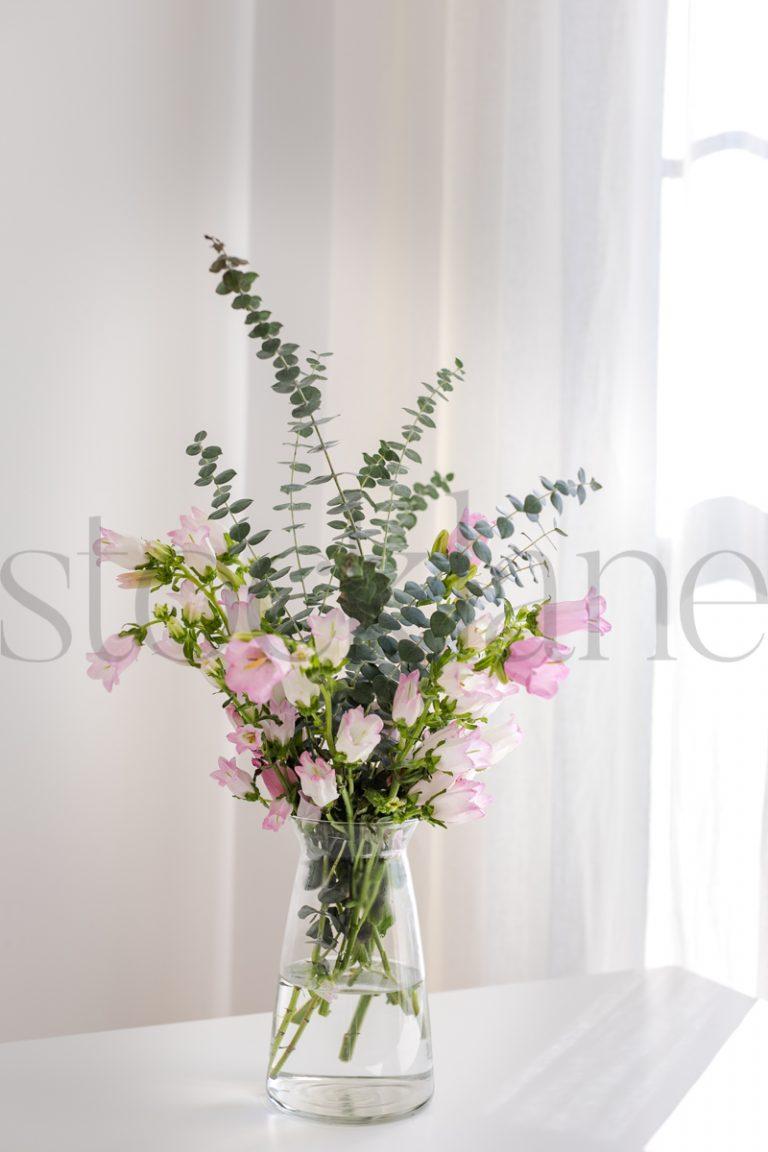 Vertical stock photo of flowers in vase