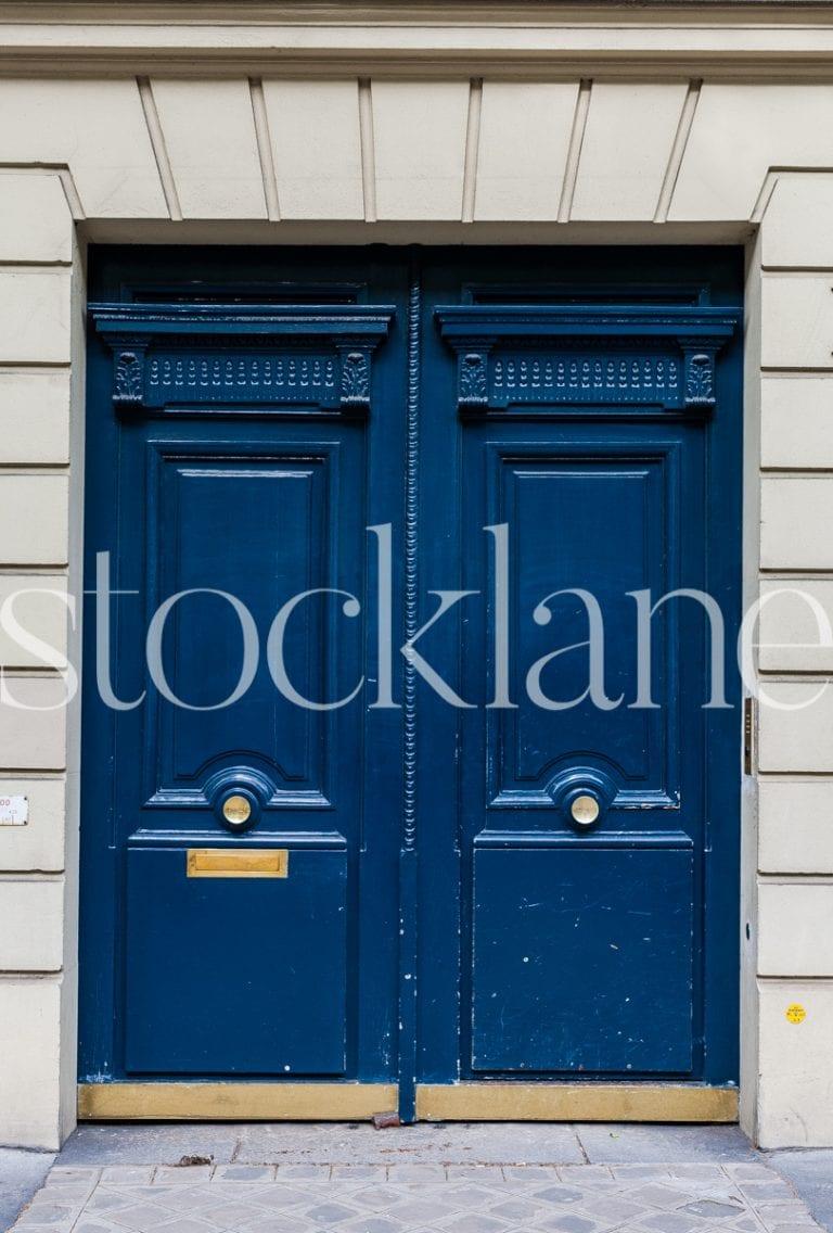 Vertical Stock photo of a blue door in Paris