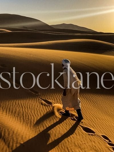 Vertical Stock travel photo of Berber man in Moroccan desert