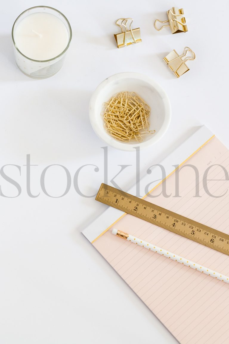 Vertical stock photo of feminine desktop
