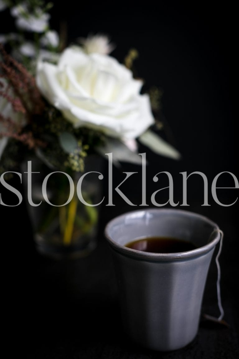 Vertical stock photo of tea and white flower