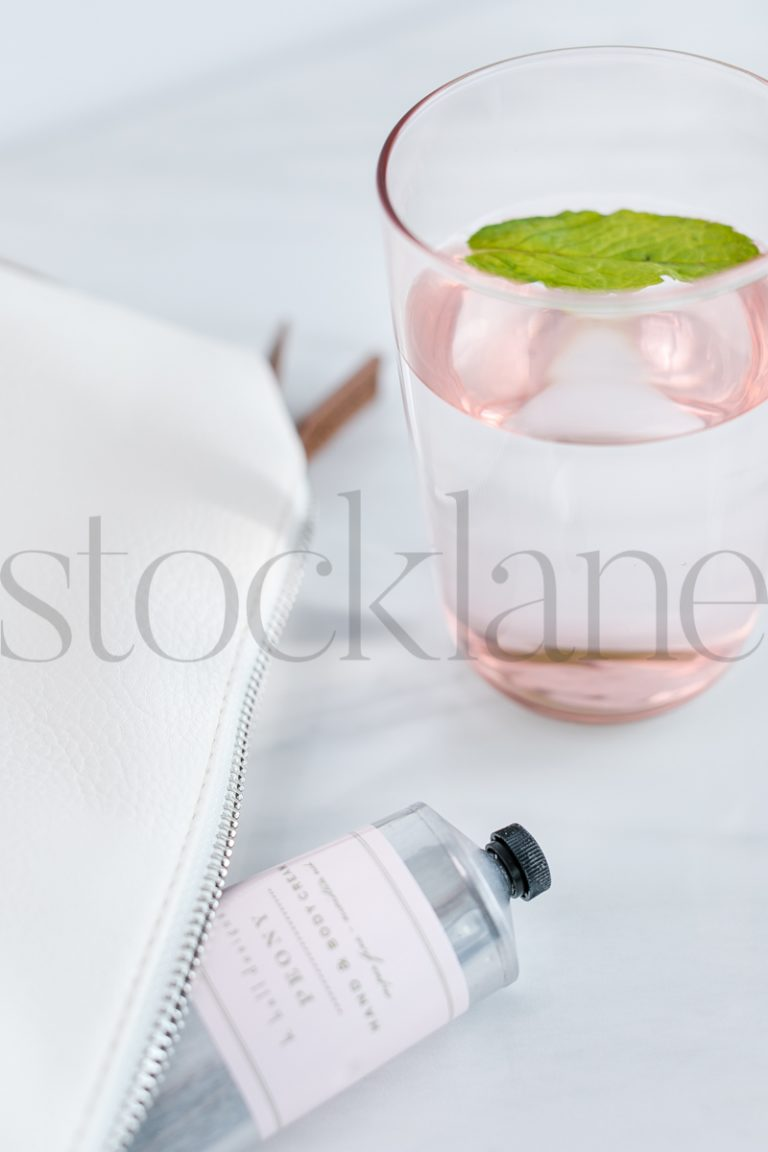 Vertical Stock photo of glass of mint water and lotion