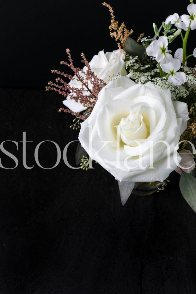 Vertical stock photo of white flower arrangement
