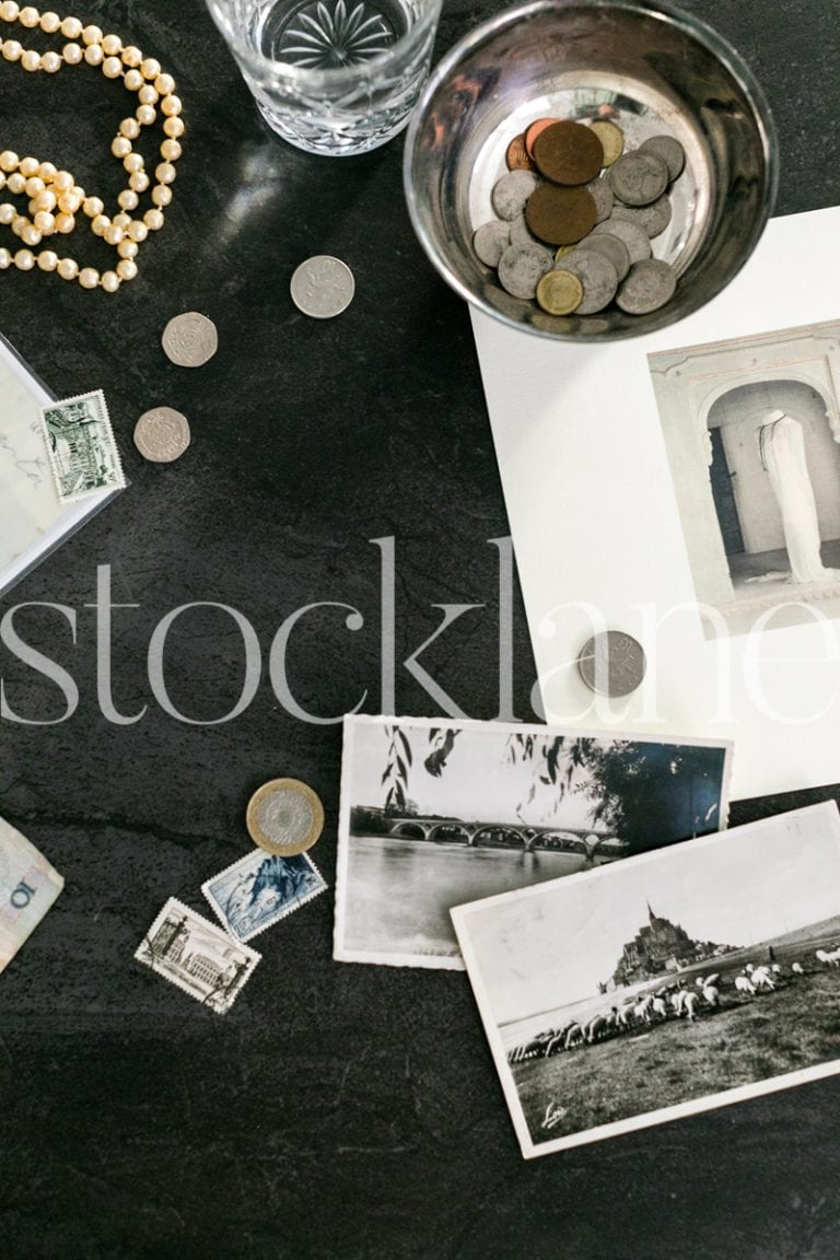 Vertical stock photo of coins and stamps