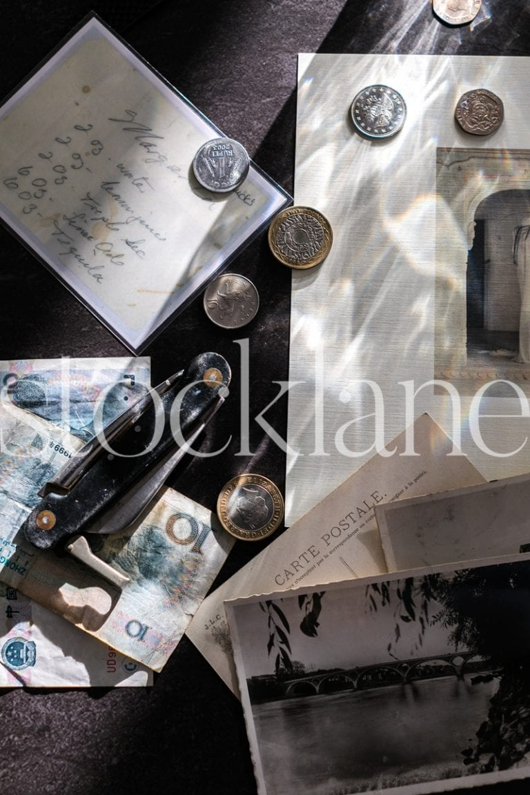 Vertical stock photo of travel coins and notes