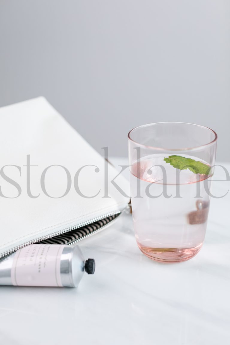 Vertical Stock photo of mint water and lotion