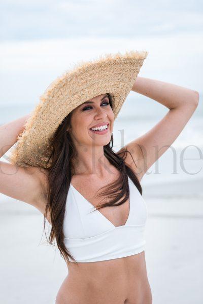 Vertical stock photo of woman in white bikini