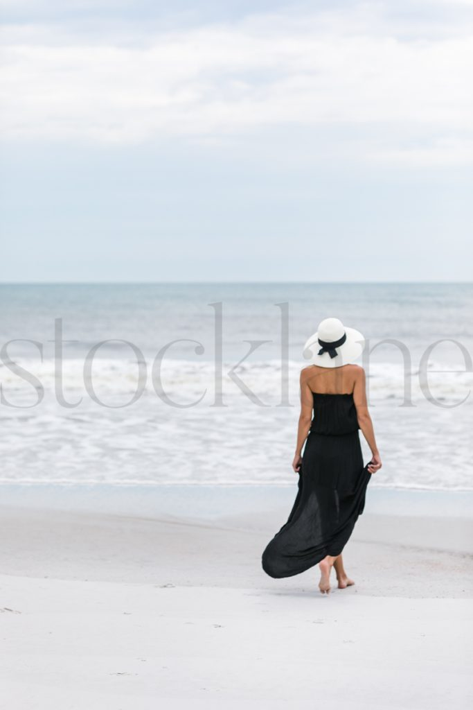 Vertical stock photo of woman at the beach