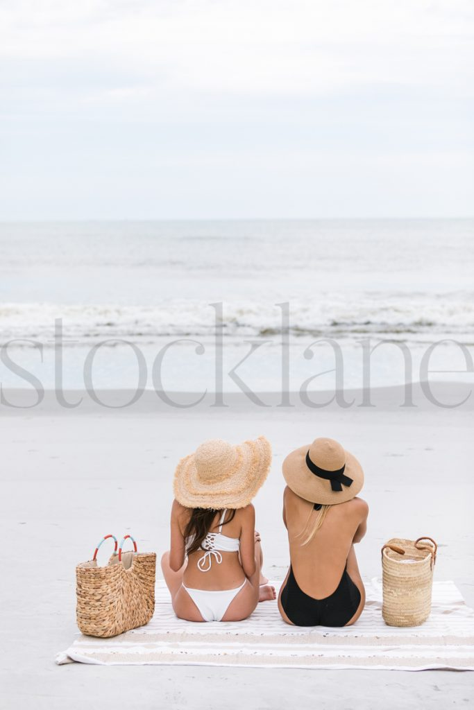 Vertical stock photo of two women at the beach