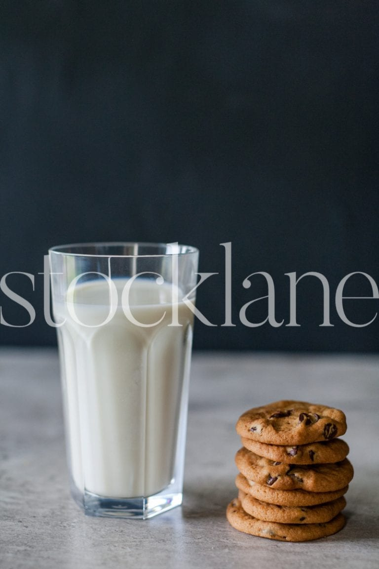 Vertical stock photo of milk and cookies
