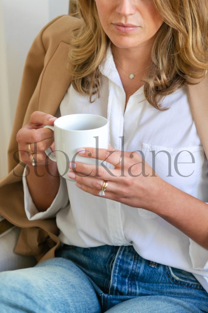 Vertical stock photo of woman drinking coffee