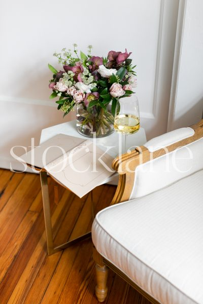 Vertical stock photo of flowers and wine