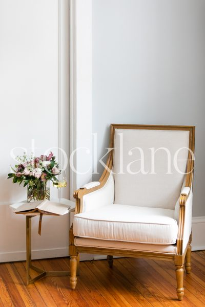 Vertical stock photo of armchair and flowers