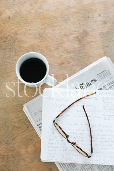 Vertical stock photo of desktop with coffee