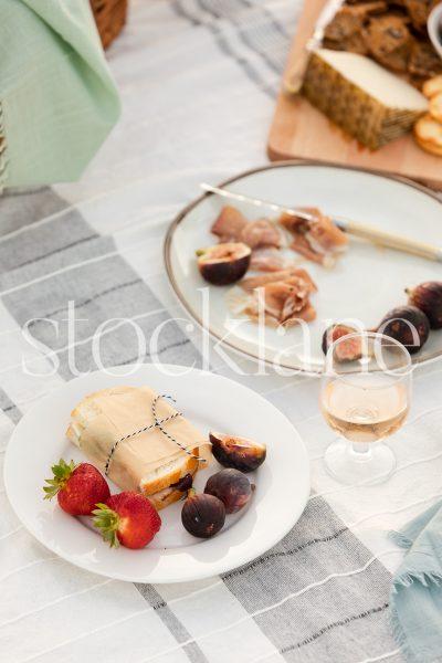 Vertical stock photo of summer beach picnic.