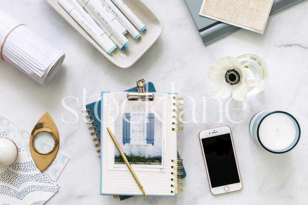 Horizontal stock photo of blue designer desktop