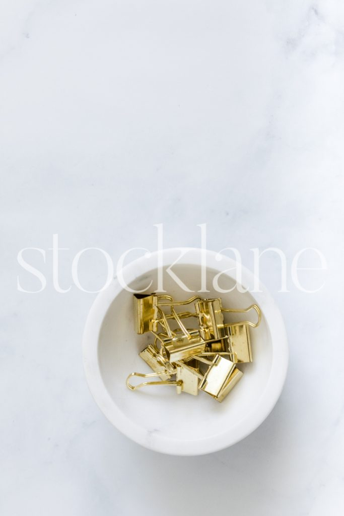 Vertical stock photo of bowl with gold clips