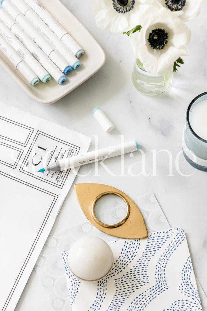 Vertical stock photo of blue designer desktop
