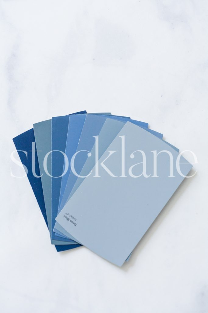 Vertical stock photo of blue paint samples