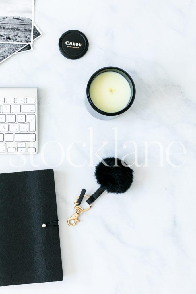 Vertical stock photo of desktop with black accessories.