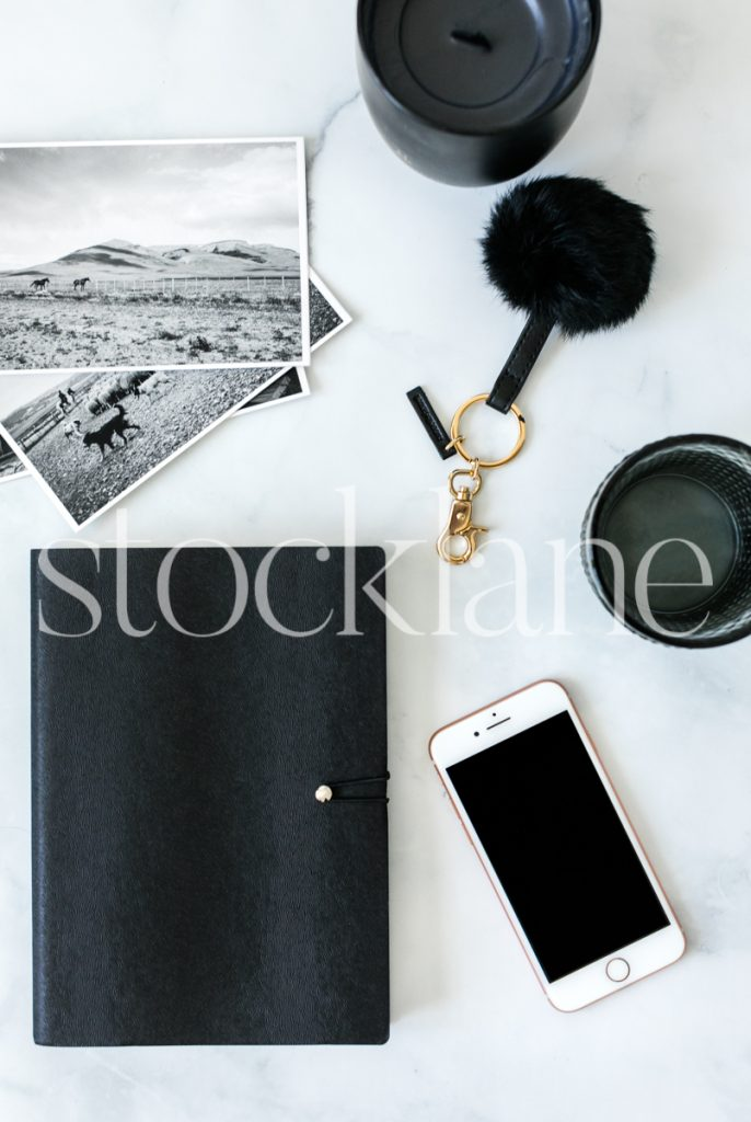 Vertical stock photo of desktop with black accessories