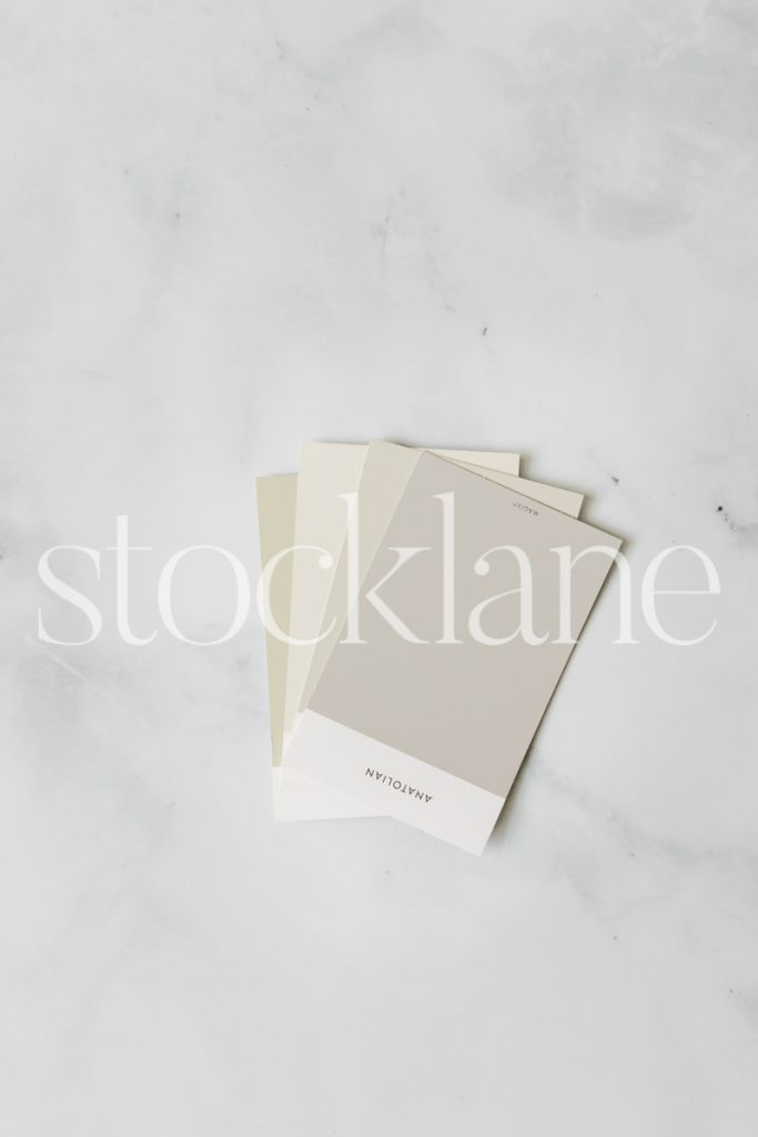 Vertical stock photo of neutral colored paint color sample cards.