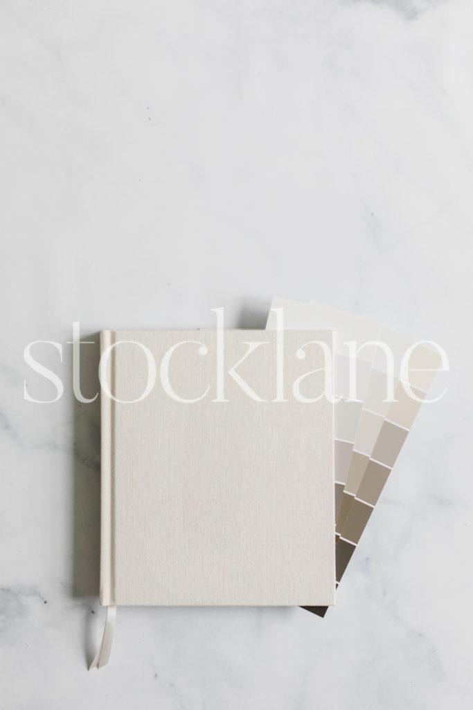 Vertical stock photo of designer neutral desktop