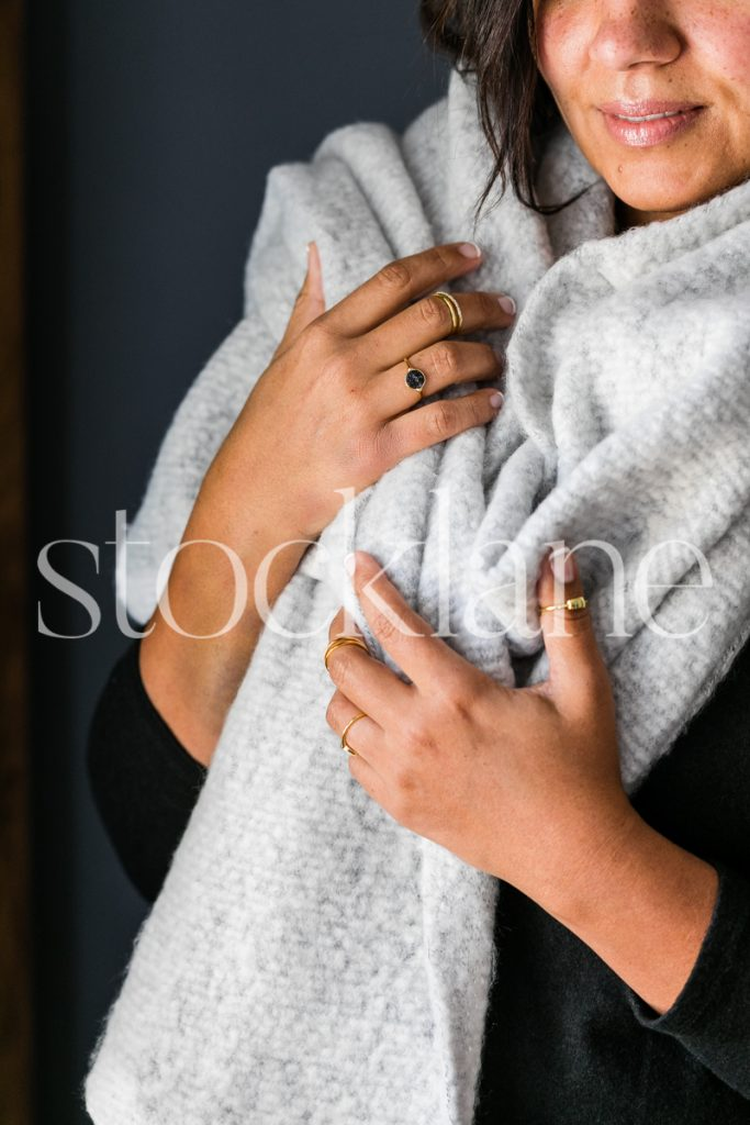 Vertical stock photo of woman with a cozy scarf