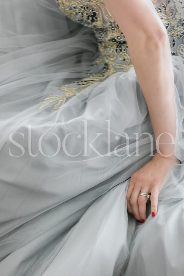 Vertical stock photo of a woman in a light blue dress
