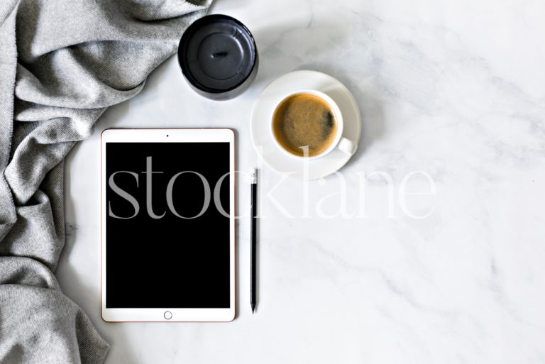 Horizontal stock photo of a desktop with an iPad and a cup of coffee