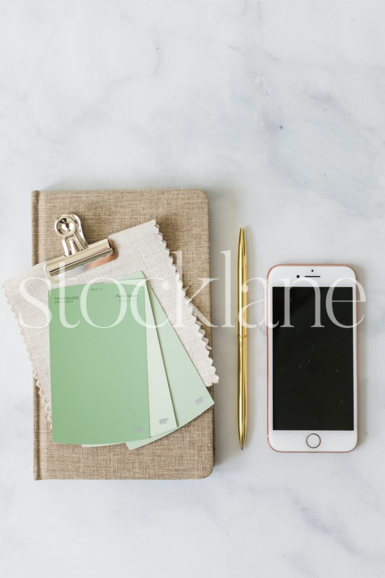 Vertical stock photo of a desktop with an iPhone