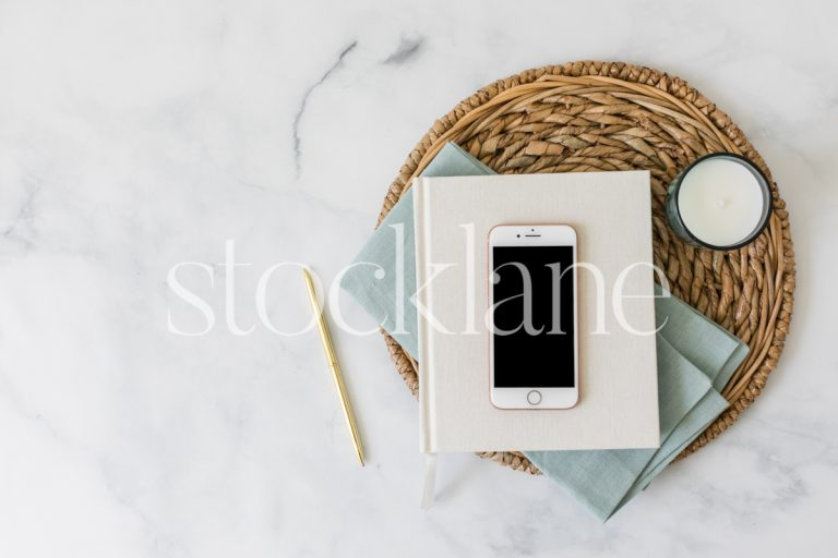 Horizontal stock photo of a flat lay with an iPhone