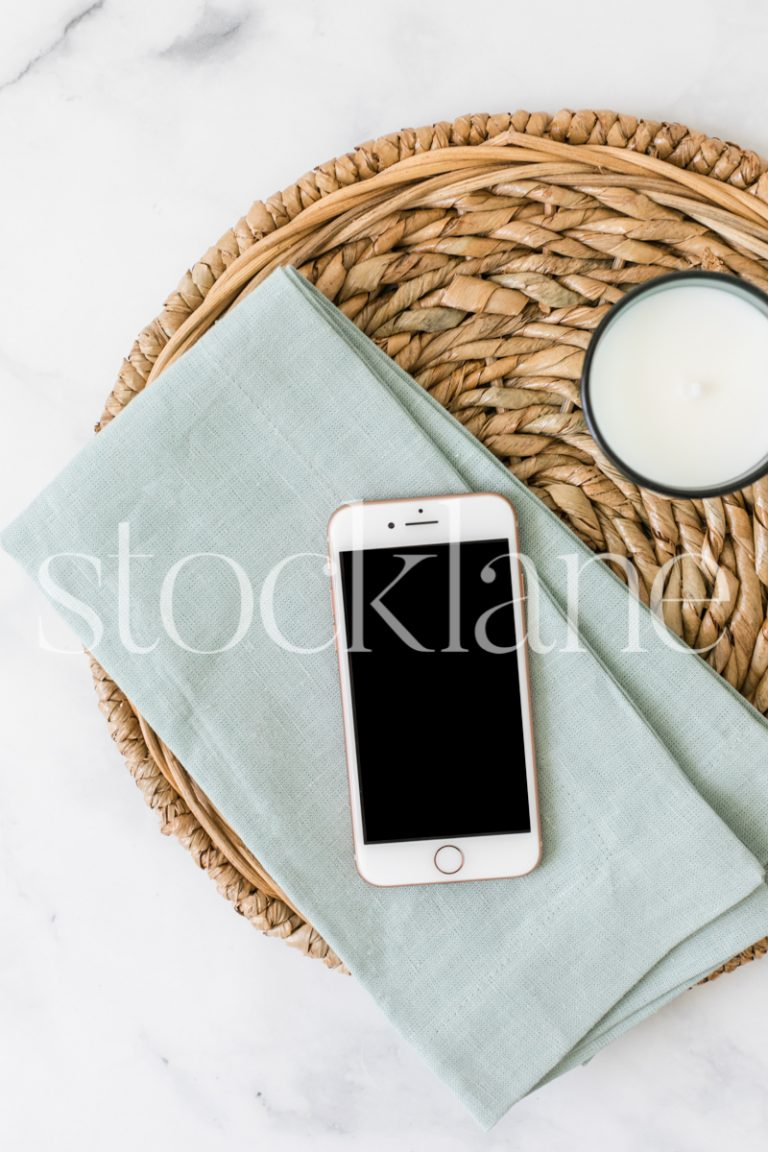 Vertical stock photo of a flat lay with an iPhone