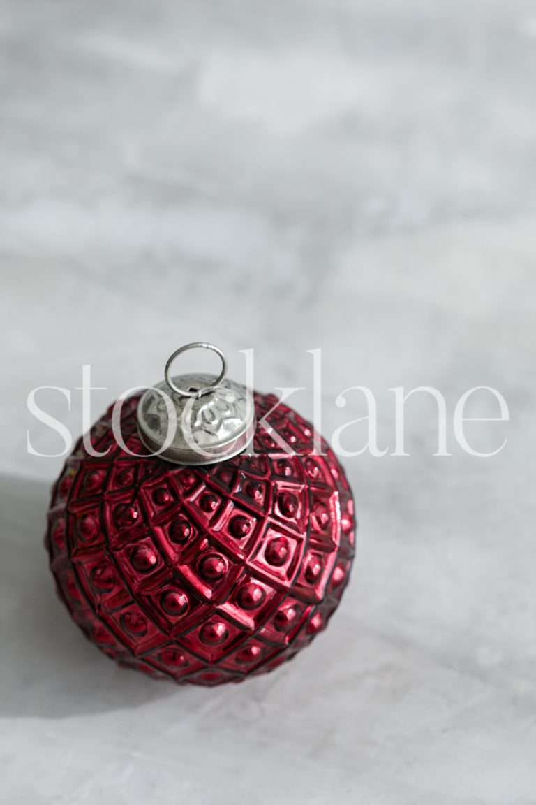 Vertical stock photo of red Christmas ornament.