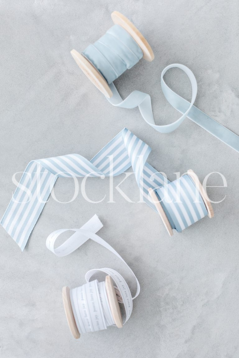 Vertical stock photo of Christmas light blue ribbons