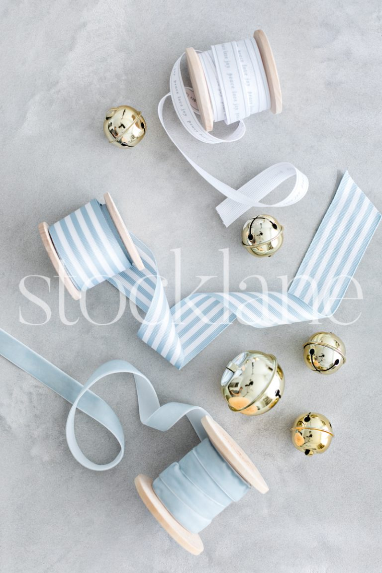 Vertical stock photo of Christmas light blue ribbons and bells.