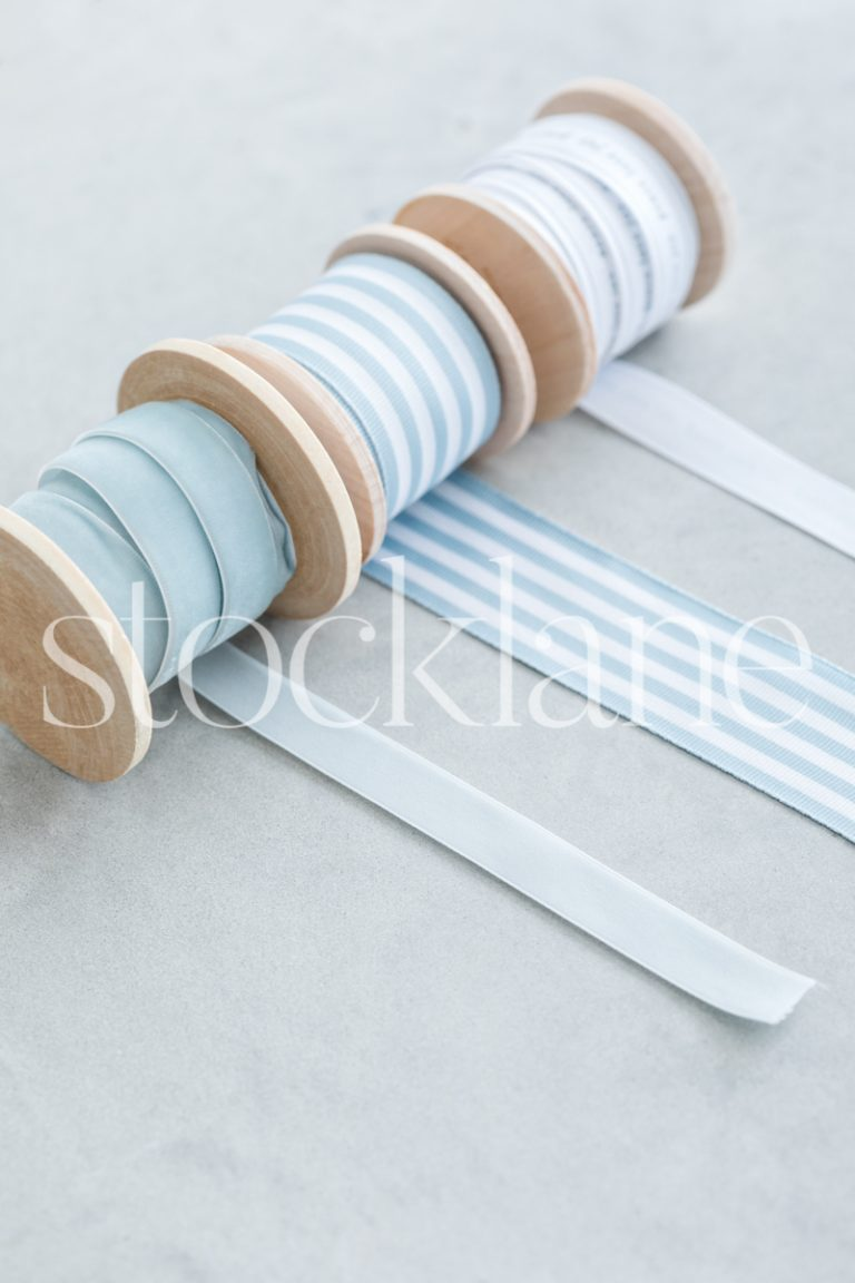 Vertical stock photo of Christmas light blue ribbons.