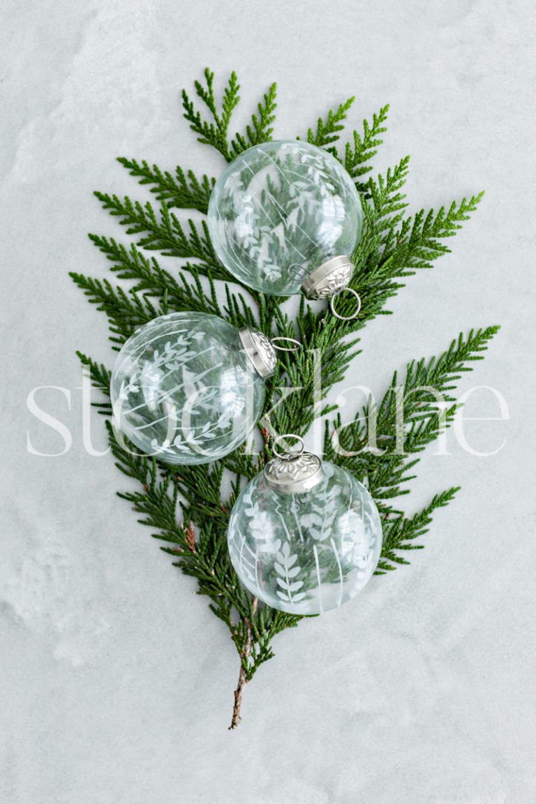 Vertical stock photo of glass Christmas ornaments.