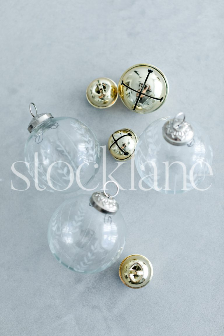 Vertical stock photo of Christmas glass ornaments and bells.