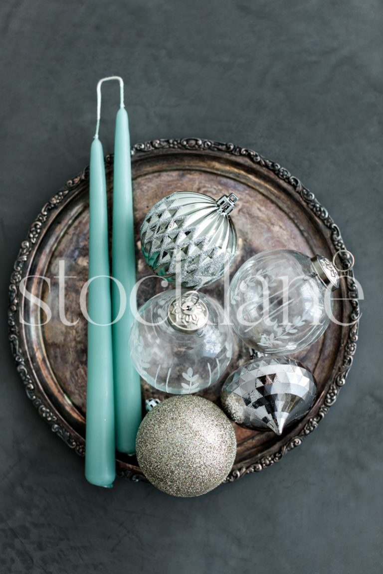 Vertical stock photo of Christmas ornaments and candles.