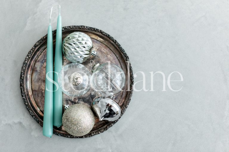 Horizontal stock photo of Christmas ornaments and candles.