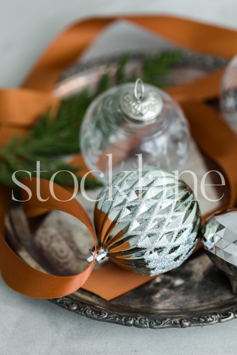 Vertical stock photo of Christmas ornaments.